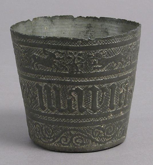 Beaker Date: 15th century Culture: French Medium: Pewter Dimensions: Overall: 2 1/2 x 2 11/16 in. (6.3 x 6.9 cm) Classification: Metalwork-Pewter Credit Line: Rogers Fund, 1930 Accession Number: 30.131