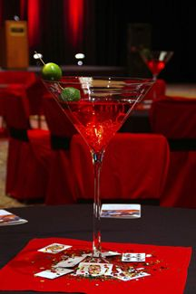 "Vegas/""Rat Pack"" theme martini glass centerpiece. Use LED olive picks to add light."