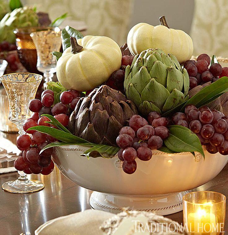 Create an artful, autumnal centerpiece arrangement with white pumpkins, artichokes and grapes.