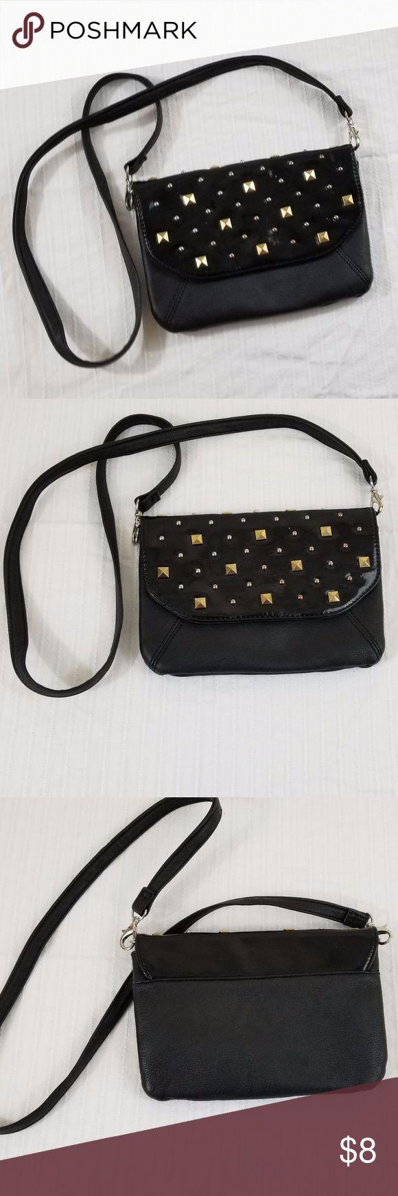 "Grace Adele Small Handbag Grace Adele Small Handbag with Studded Accents Good used condition Some minor wear and some light discoloration on inside Detachable strap so it can be used as a strap Purse Measurements : 9 x 6.25 "" Entire length of strap 44"" Grace Adele Bags"