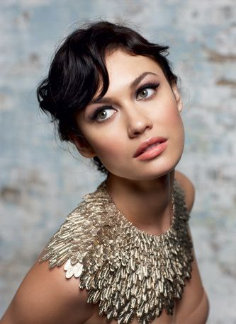 Love this bib statement gold necklace on Olga Kurylenko.  Reminds of the ones Ancient Egyptian royalty wore.
