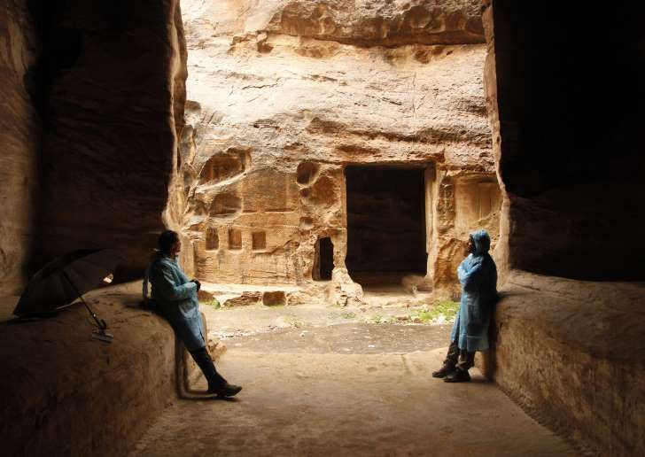 Fear of flash floods had closed the main site of Petra, pushing adventurous tourists to buy umbrellas and plastic ponchos to see the smaller 2,000-year old site.