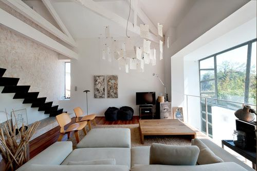 Le Prado by Maurice Padovani - Nice mix of whites with warm wood tones. I love the lighting fixture too!