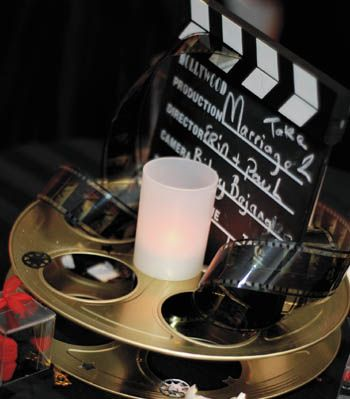 Table centerpieces made from movie film reels and cameramen's clap-boards