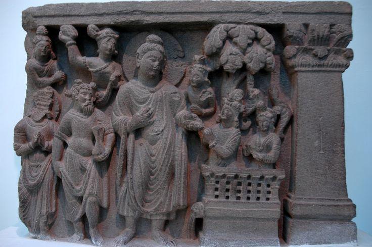 """Buddha with Naga-Kalika,"" c. 100's CE, a Gandharan sculpture now in the National Museum, Delhi"