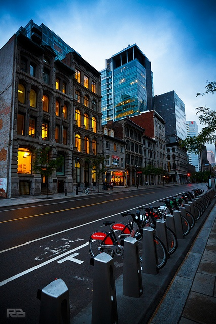 This photo is so typical Montréal - Old and modern buildings, and Bixi bikes!