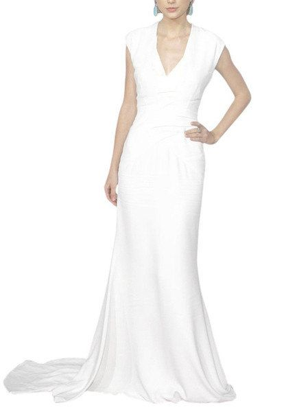 Luxurious yet relaxed wedding dress in pure ivory colour featuring sleeveless A Line silhouette, V neckline with short chapel train.