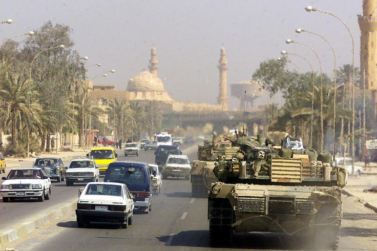 Two U.S. Marine Corps M1 Abrams tanks patrol the streets of Baghdad, Iraq on April 14th, 2003. Official US DoD photo