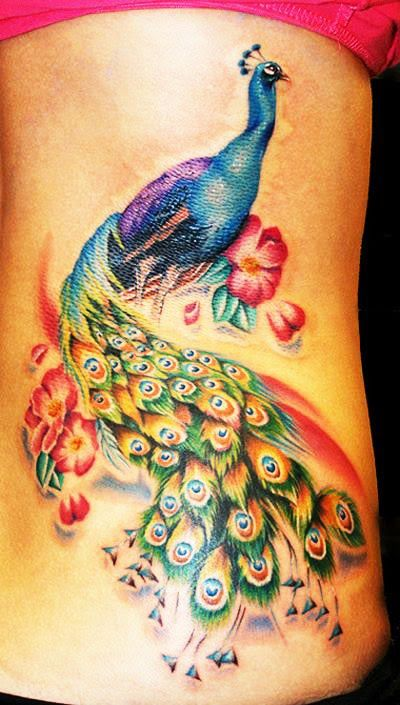 The colors in this tattoo are stunning. I know they say that tattoos without heavy outlining are a no-no, but I love them.