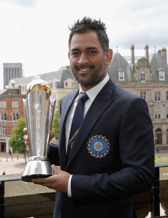 India captain MS Dhoni, opener Shikhar Dhawan and all-rounder Ravindra Jadeja displayed their prizes at a photocall in Birmingham a day after beating England in the final of the 2013 Champions Trophy.