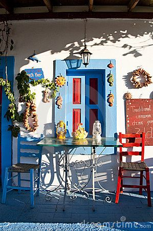 Brightly coloured taverna on the island of Kos, Greece - the cradle of western civilization - enjoy Retsina, Ouzo, Octupus, Feta and the warm sun on your face. Bliss.