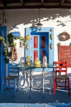 Brightly coloured taverna on the island of Kos, Greece - the cradle of western civilization - enjoy Retsina, Ouzo, Octupus, Feta and the warm sun on your face. Bliss.