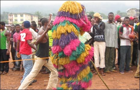 This is Odogwu which means strength: It is exclusively led by the youth or young adults. It is a youthful and aggressive spirit, its major attribute is demonstration of youthful strength with specialty in intimidation. This masquerade always have a rope tied to its waist and held at the back by the two strongest men in the group. Often times a cross bar is used before it as another measure to restrain this strong spirit from tearing things apart.