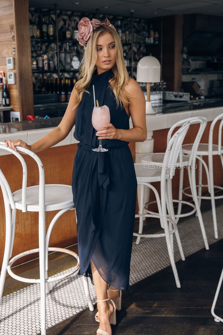 The Amaryllis Dress in Navy is a dream. With halter neck, low back and waist tie details this dress suits every woman. A split skirt allows room to move with added rouching inspired by the hourglass figure. This dress is for those attending a wedding or in the wedding, our soft peach colour is ro...