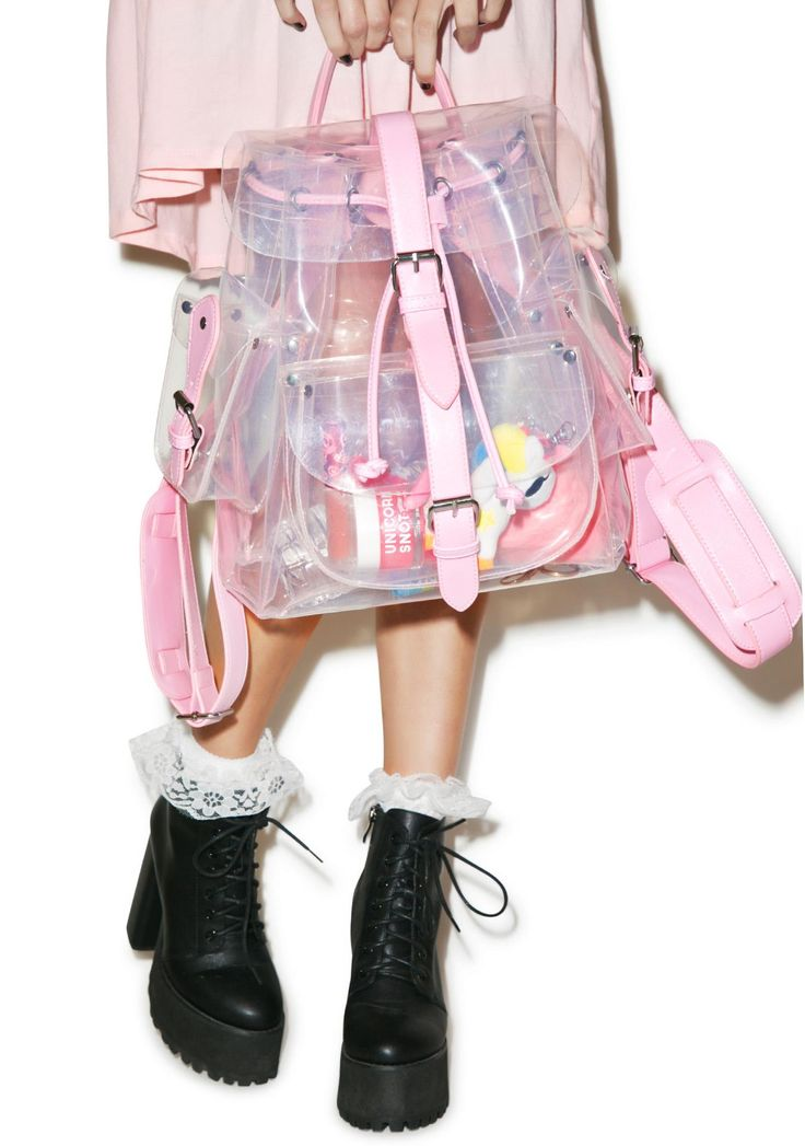 Teenage Dream Backpack might just be the cutest thing we've ever seen. This adorable backpack features a clear construction and multiple exterior pockets. With pretty pink vegan leather trim, adjustable shoulder straps, roomy interior for all yer sweet possessions and front buckle closure.