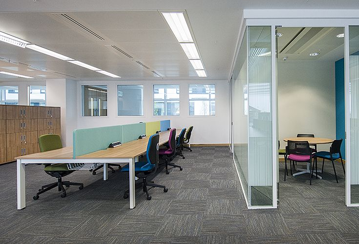 Freeway desks, by Torasen, were supplied for workstation areas along with dividing screens and task chairs