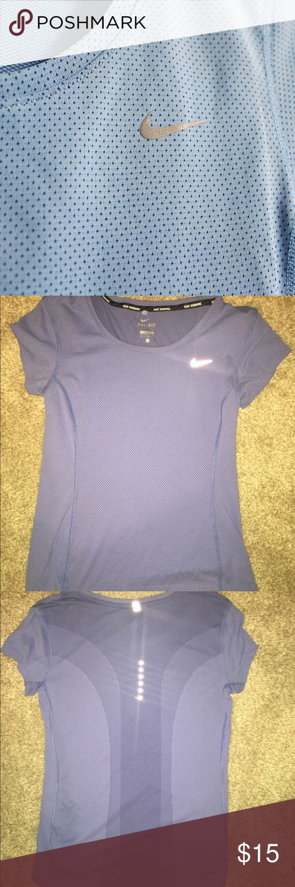 Nike Running Miller Shirt This is a unique dry fit shirt! The pattern is so pretty and the detail on the back is gorgeous! I never wore this shirt. Please make offers! Nike Tops Tees - Short Sleeve