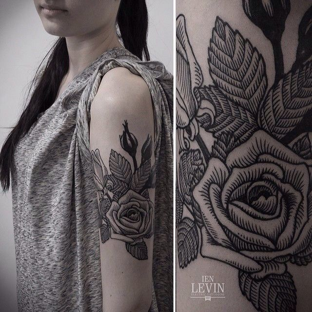 Black and gray rose tattoo; arm