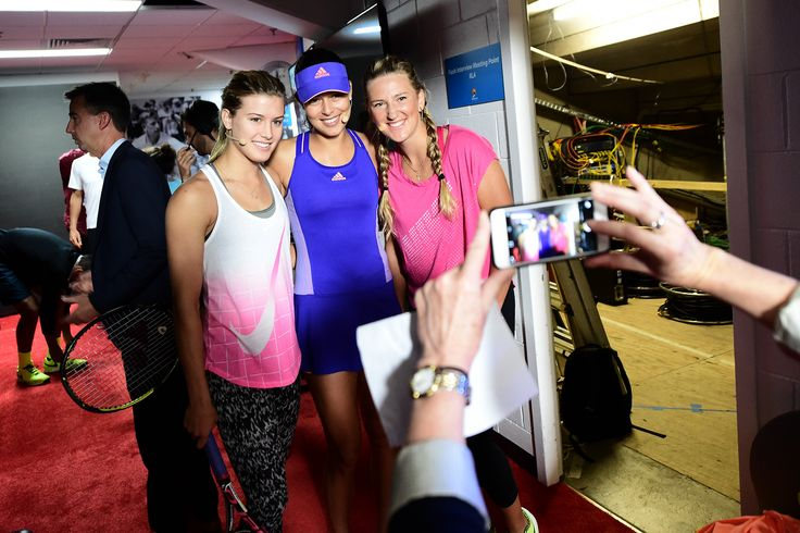 Eugenie Bouchard, Ana Ivanovic and Victoria Azarenka pose for photos before stepping out onto Rod Laver Arena