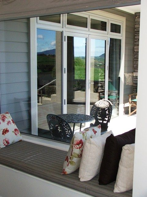 Picture window and french doors, stylish.