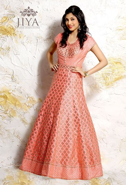 Chanderi brocade in an elegant peach color cascades in an Empireline Anarkali. Finished with Gota & Pitta work on the neckline and sleeve hem. The silver edgings on the refreshing peach add subtle elegance to the outfit.  The style comes with a matching churidar and dupatta.