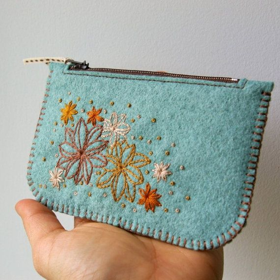 I couldn't decide where to put this - machine embroidery or creating handbags.  I can envision making these with an embroidered monogram on them.  I think this one is hand embroidered.  I found a place to buy wool felt by the bundle, all different colors, for a really great price!