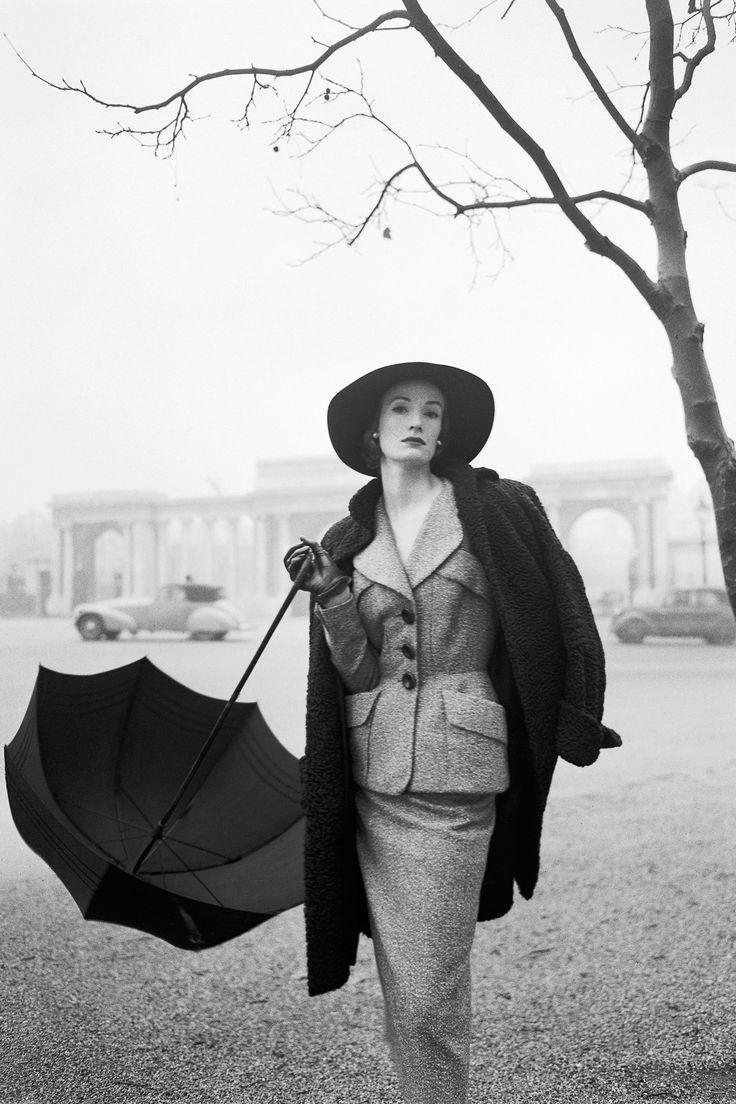 Vogue, 1951 - Wenda Parkinson wearing a Hardy Amies suit near Rotten Row, Hyde Park Corner.