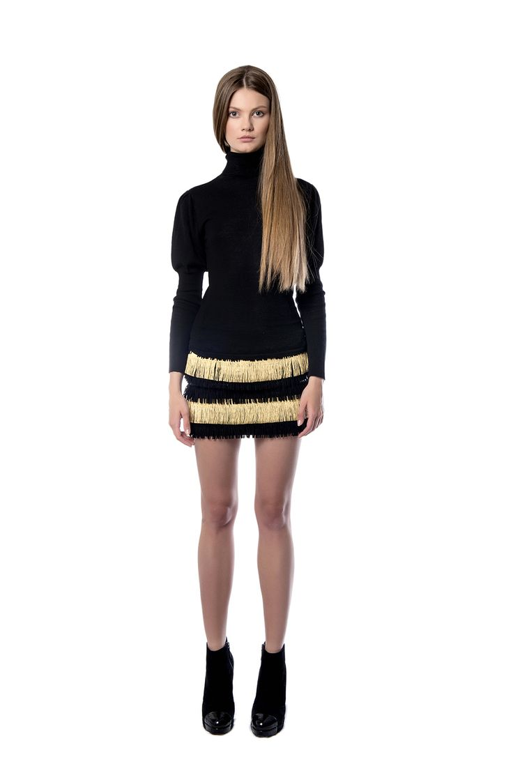 Black and gold fringed mini skirt  This black – and – gold fringed mini skirt sits at the waist. The design is created from viscose and is covered in tiers with nylon fringe. Wear it with a tonal top and sandals.