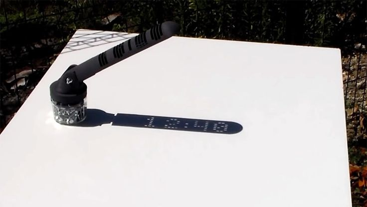 Using a clever mix of 3D printing and a few well-placed shadows, this sundial designed by Mojoptix projects the actual time as if displayed on a digital clock. The plastic component that casts the shadow—called a gnomon— is printed with extremely tiny holes that create pinpoint dots of light in th
