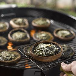 Big brown mushrooms with basil pesto. Perfect for the vegetarians who still love to braai.