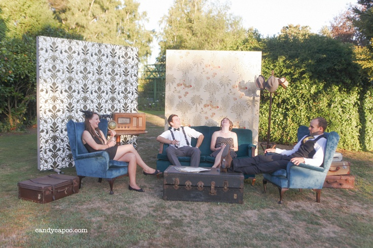 A Vintage & Pretty outdoor lounge suit complete in wing back chairs, a couch, trunks and side tables.     Photography by Candy Capco