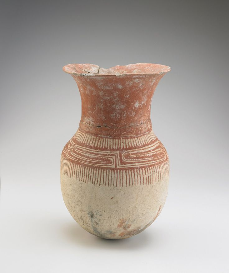 VESSEL WITH ROUND BOTTOM  Earthenware with white slip and red pigment 39.5 x 25 cm Ban Chiang culture 300 BCE-1 CE, Ban Chiang culture, late period Origin: Northeast Thailand Gift of Victor and Takako Hauge S2004.19 DESCRIPTION  Ovoid vessel with wide neck and everted rim. Body bears curvilinear and geometric designs in red pigment on a white slip background. Neck and rim are coated with red pigment.