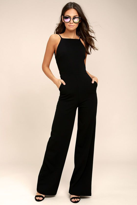 Lulus Exclusive! The night is yours in the Something to Behold Black Jumpsuit! Sleek stretch knit forms a fitted bodice with darting and a high apron neckline. Spaghetti straps frame a sexy open back, while pant legs fall below the fitted waistband with diagonal front pockets. Hidden back zipper.