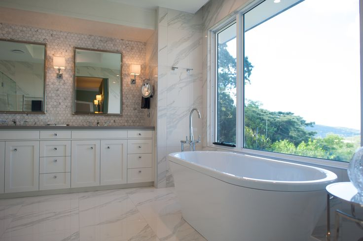 Beautiful Master Ensuite featuring marble tiles, free-standing bath and decorative mirrors.