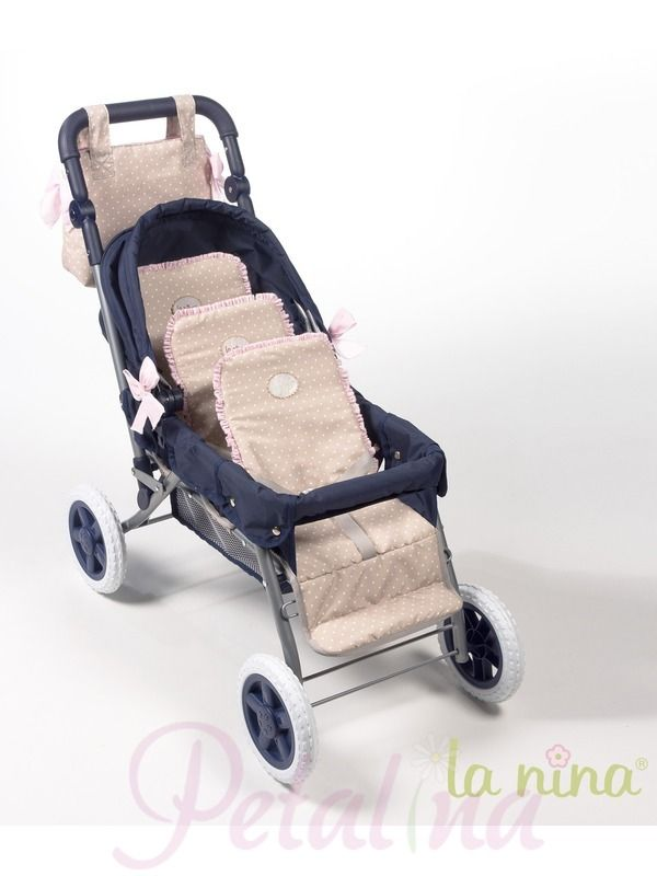 We were really lucky to be able to purchase this triple dolls pram. Whenever we have tried in the past they have sold out as they are so popular! This year the colour is predominantly navy blue with cappuccino fabric with white polka dots trimmed with pale pink fabric with polka dots. The pram folds down for storage or going in the car.
