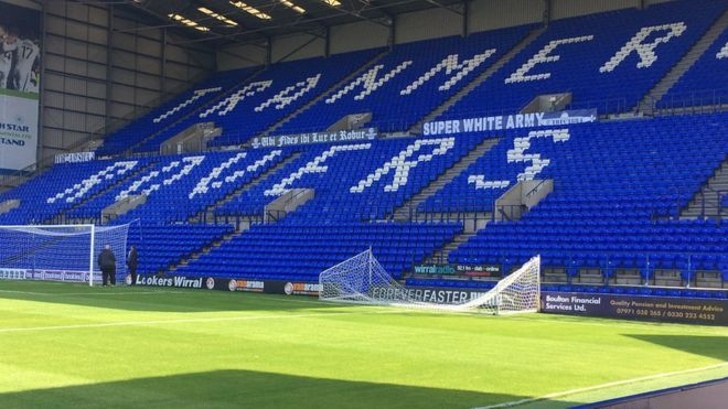 FA covers up 'Super White Army' banner at Tranmere Rovers. Tranmere Rovers' Prenton Park ground