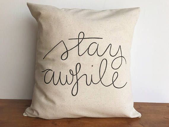 Stay awhile pillow cover for 18 x 18 inch pillows This fun pillow lets your guests know they are welcome to kick off their boots and stay awhile! It would look beautiful as a couch pillow in any home. Each pillow is hand sewn with an envelope style closure on the back and hand painted when your order is placed. The pillows are 100% unbleached natural cotton. This particular fabric has a gorgeous speckled appearance as seen in the last photo. The pillow cover is a light beige, but it is…