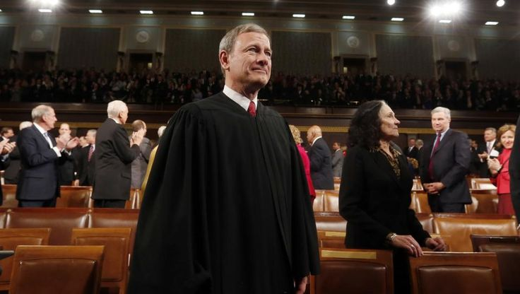 Supreme Court New Term Supreme Court Chief Justice John Roberts in the House chamber on Capitol Hill waiting for the President's State of the Union address to begin on Jan. 28, 2014. (AP Photo/Larry Downing)