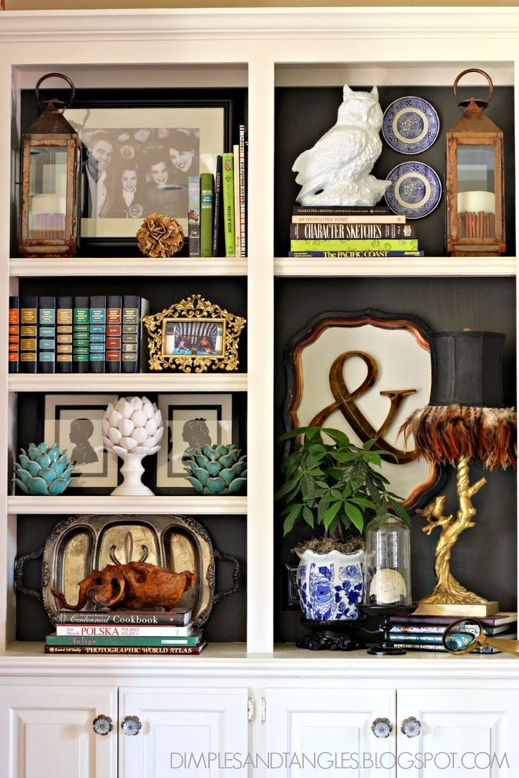 Styled Shelves: lots of layering with flat ornamentals (trays, pictures frames/art, dishes) behind sculptures, books, and other 3D objects.
