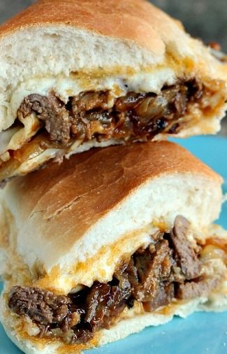 Amazing steak sandwich layered with caramelized onions, mozzarella cheese and barbecue sauce.