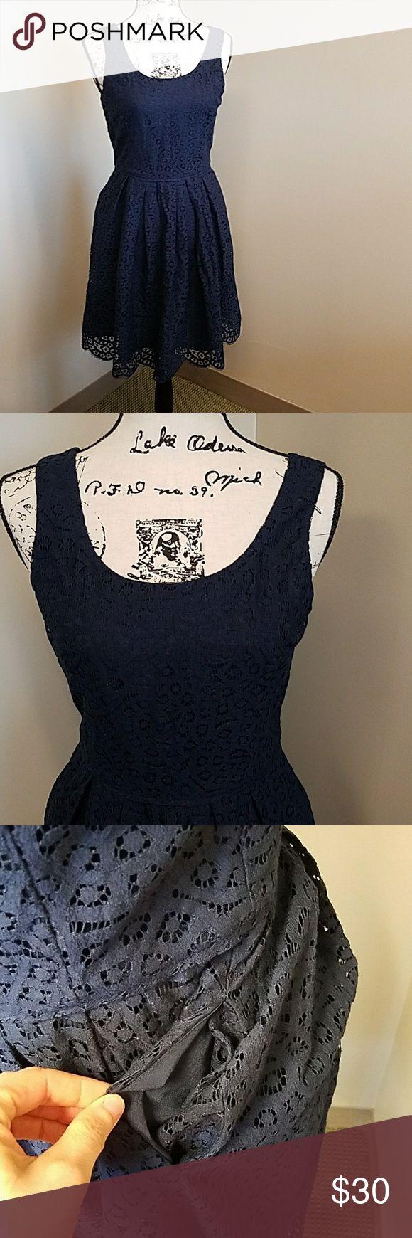 J. Crew navy lace dress J. Crew navy lace dress. Lined, has pockets. Zipper in back. J. Crew Dresses Mini