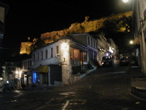 An unexciting shot of an empty street at night with a vague outline of a fortress in the background, but at least I didn't use unnecessary flash. Gjirokastra, Albania.