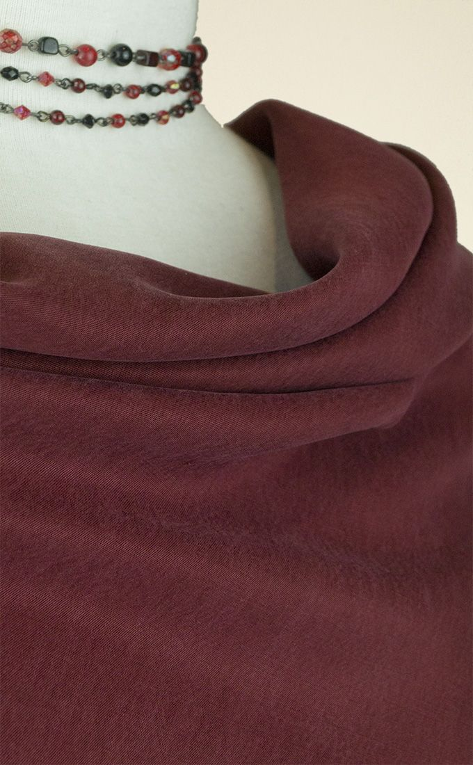 Draping, richly-coloured burgundy cupro fabric with a slightly washed finish, perfect for dresses, tops and flowing separates.
