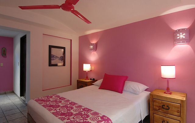 Pink bedroom in the hotel Catedral, Vallarta, Mexico