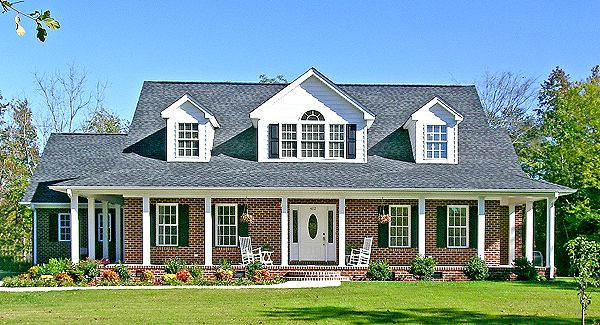 A covered wrap-around porch and lovely arched windows give this home a comfortable country style. The attached garage is set way back to minimize it's impact and help retain the classic farmhouse appeal.