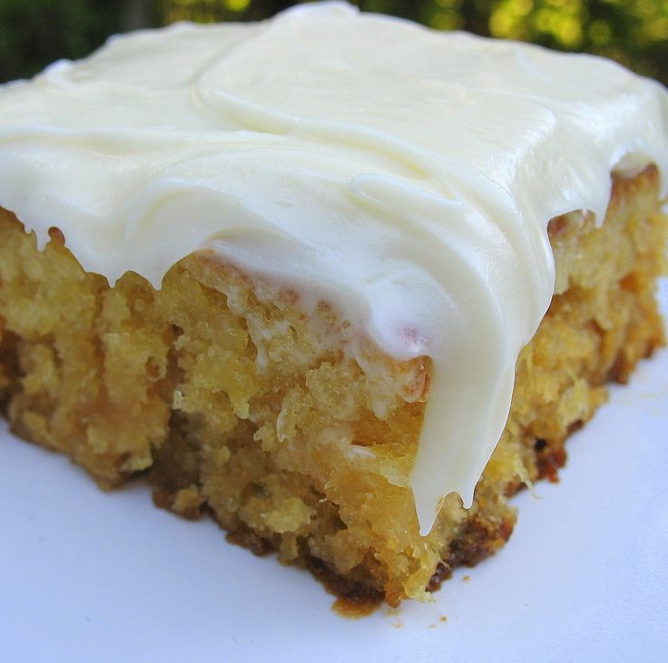 """Miss Susan's Pineapple Sheet Cake - Made it for our July 4th BBQ and after frosting the cake I told hubby I really hoped I liked it because it was SO easy to make.  Well, I'll have to say I LOVED this cake!  I loved the thick dense texture of this cake.  And SO moist.  And the cream cheese frosting...well, it was """"the icing on the cake""""!  LOVE and will definitely make again!"""