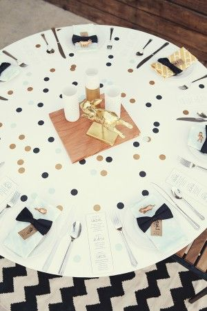 Graphic polka dot table- large dots punched out and spread on tables like confetti