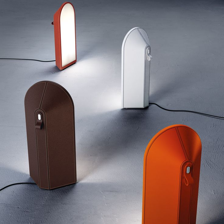 Odeon (lighting): Floor lamp. Diffuser in milk white polycarbonate. Structure covered in cuoietto leather, available in the following colours: orange with black stitching, white with blue stitching, cognac with rope stitching and dark brown with brown stitching. Black power cable and switch. Wall washer light emission. (designer: Studio Klass   2013) - More @ www.fontanaarte.com #fontanaarte #light #lamp