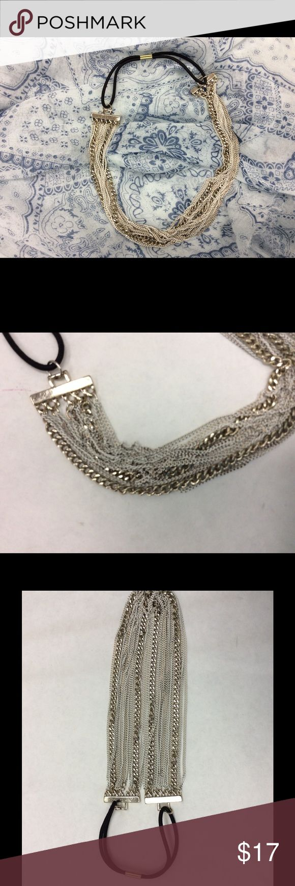 Free People white and silver chain headband NWOT New Free People chain headband . Multiple white and gold chains with  a black stretch band. Length unstretched 10 inches stretched 13 inches.    Psku 49c Free People Accessories Hair Accessories