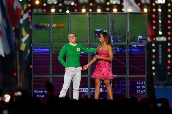 Jessica Mauboy Photos Photos - Sally Pearson of Australia and Jessica Mauboy on stage during the Closing Ceremony for the Glasgow 2014 Commonwealth Games at Hampden Park on August 3, 2014 in Glasgow, United Kingdom. - 20th Commonwealth Games: Closing Ceremony